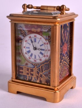 A Miniature French Ormolu Carriage Clock Inset With