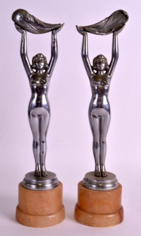 A Pair Of Art Deco Chrome Figures Of Females Modelled