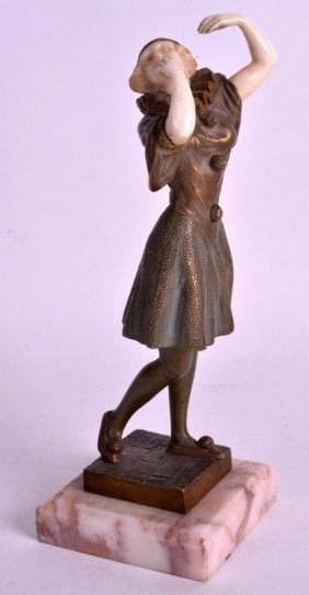 An Art Deco French Cold Painted Bronze And Ivory Figure
