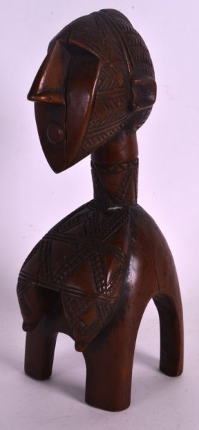 An Early 20th Century African Carved Wood Figure With