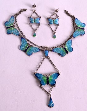 A Silver And Enamel Butterfly Necklace Together With