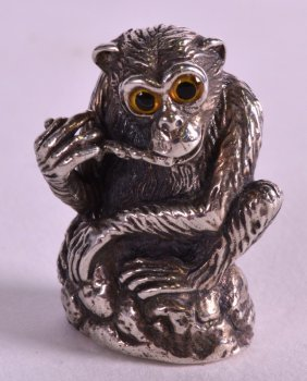A Novelty Silver Wise Monkey Pin Cushion.