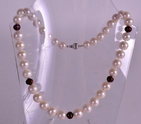 A Ladies 18ct White Gold Pearl And Ruby Necklace.