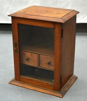 A Small Oak Display Cabinet With Two Internal Drawers.