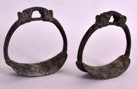 An Unusual Pair Of Chinese Qing Dynasty Bronze Stirrups