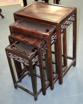 A Nest Of Four Chinese Carved Hardwood Tables. Largest