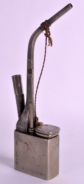 A 19th/20th Century Chinese Silvered Opium Pipe. 9ins