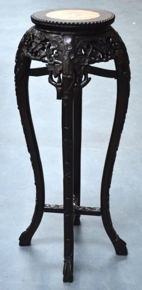 A Late 19th Century Chinese Carved Hardwood Stand With