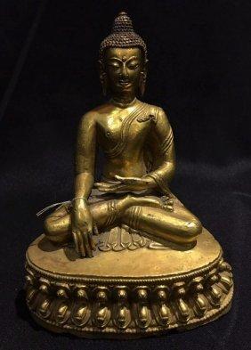 A Gilt- Bronze Figure Of Shakyamuni Buddha