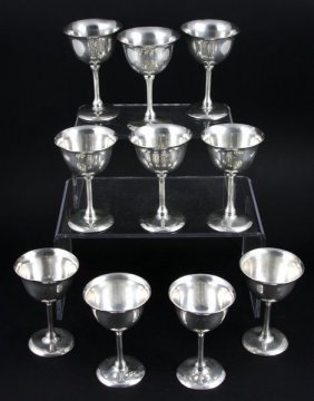 "Eleven (11) .900 Silver Wine Glasses, 4 1/2""h."