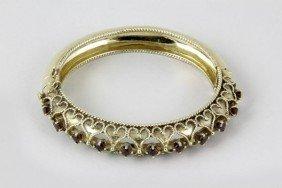 Eleven 14K Gold Garnet Bangle Bracelet