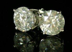 Pair Of 14K White Gold Diamond Stud Earrings, Each