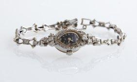 Lady's 14k White Gold Bulova Wristwatch, Ser # 704337,
