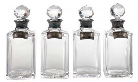 Four Venetian Style Crystal Decanters