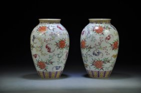 A Pair Of Chinese Polychrome Decorated Vases Depicting