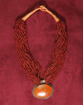 Chinese Pendant In Carved Red Coral