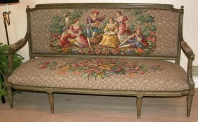SETTEE ANTIQUED CARVED WOOD FRAME IS 19TH C.