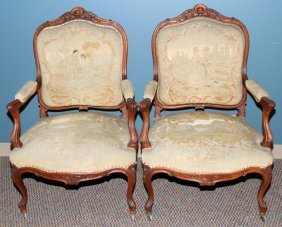 LOUIS XV STYLE CARVED WALNUT OPEN ARM CHAIRS,