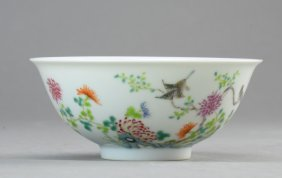 A Famille Rose Bowl In Flowers And Birds Pattern Marked