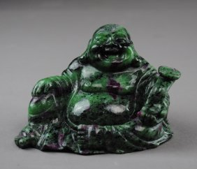 A Mira Buddha Sculpture Carved In Ruby-stone