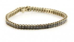 LADIES 14K GOLD AND DIAMOND TENNIS BRACELET