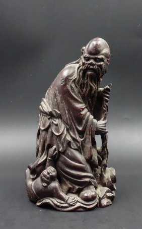 A Chinese Bamboo Carved Figure Of Laoshou