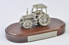 Scarce Pewter Ford 7810 Tractor Mounted On A Plinth.