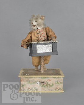 Musical Automaton Of A Cat Playing An Organ Grind