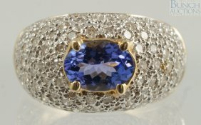 14K YG Tanzanite & Diamond Ring, 7 X 5mm Sotne,