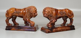 Pair Of Rockingham Style Treacle Glaze Lion Figures