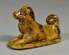 Reclining Tan, Brown, & Green Glazed Redware Dog,