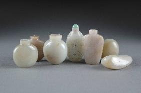 A COLLECTION OF EIGHT CHINESE CARVED JADE SNUFF BOT