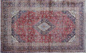 A KASHAN CARPET, THE PERSIAN ROSE FIELD Centering A
