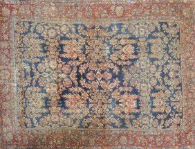 A SAROUK CARPET, THE MIDNIGHT BLUE FIELD Woven With