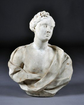 A CONTINENTAL CARVED WHITE MARBLE GARDEN BUST OF F