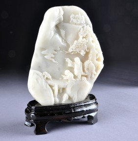 A CHINESE CARVED WHITE JADE SHOUSHAN SOAPSTONE BOU