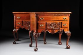 A PAIR OF CHIPPENDALE STYLE CARVED MAHOGANY THREE