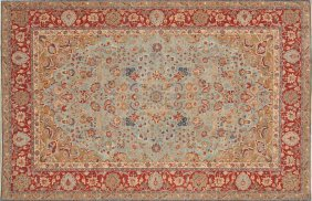 A FINE PERSIAN TABRIZ CARPET, The Powder Blue Fiel