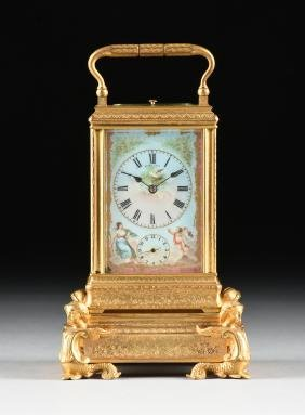 An Antique French Gilt Bronze And Porcelain Mounted