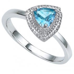 0.57 Ctw Blue Topaz & Genuine Diamond Platinum Plated .