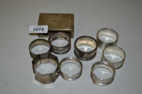 Eight Silver Napkin Rings And A Silver Matchbox Cover