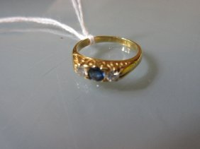 Yellow Gold Three Stone Sapphire And Diamond Ring