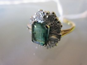 18ct Yellow Gold Emerald And Diamond Cluster Ring