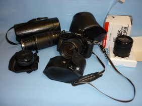 Canon Eos Camera With Accessories Together With A