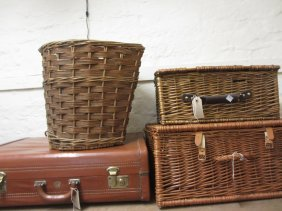 Four Wicker Baskets And An Aeropack Suitcase