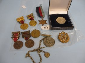 Quantity Of Various Medals And Badges Together With A