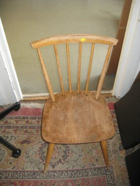 Set Of Four Ercol Stick Back Kitchen Chairs In Light