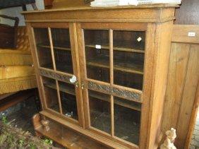 1930's Oak Two Door Bookcase Raised On Low Bun Feet