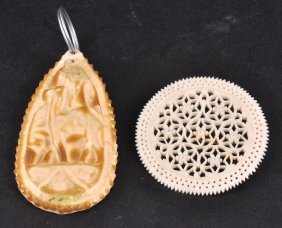 A PIERCED CIRCULAR IVORY DISC And A PENDANT (2).