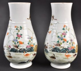 A PAIR OF CHINESE PORCELAIN ENAMELLED VASES Bearing